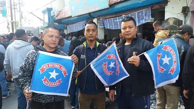 Mizo National Front supporters outside the party office in Aizawl as the party raced ahead in the Mizoram assembly elections (HT Photo)(HT)