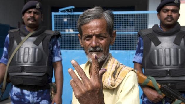 A man displays the indelible ink mark on his index fingers after casting his vote in Hyderabad, India, Friday, Dec. 7, 2018. This is the first state elections in Telangana after it was formed bifurcating Indian state of Andhra Pradesh.(AP)
