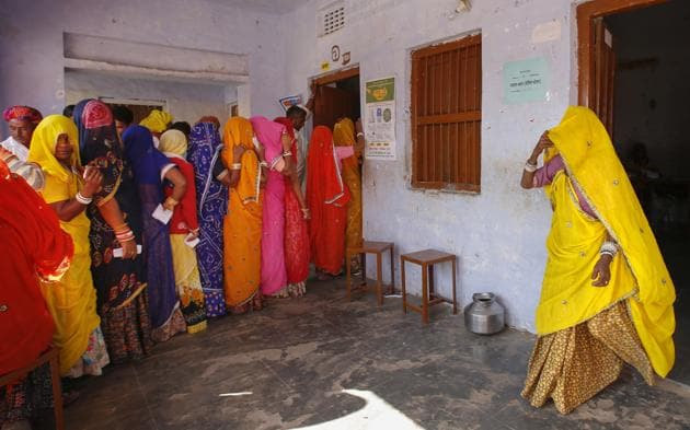 Women wait in a queue to cast their votes in village Padampura, near Ajmer, in Rajasthan assembly election, Friday, Dec. 7, 2018.(AP)