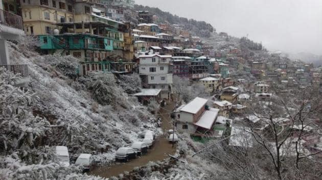 <p>A canopy of white over Shimla town after the first snowfall of the season in the popular tourist spot in Himachal Pradesh. Rohtang Pass was closed for...