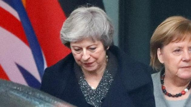 British Prime Minister Theresa May, who is boxed in on her options for Brexit, had her room for manoeuvre further diminished when she was briefly locked in her car in front of German leader Angela Merkel on Tuesday.(Reuters Photo)