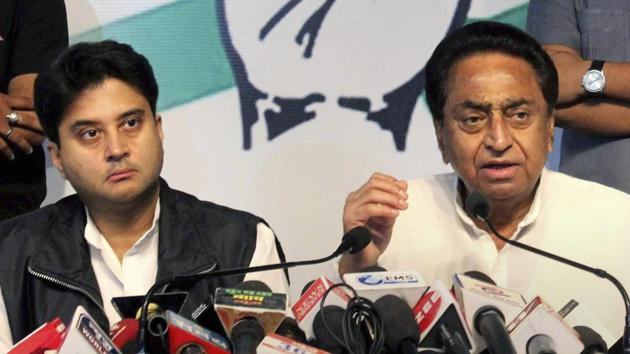 Congress state president Kamal Nath (R), party leader and MP Jyotiraditya Scindia (L) during the release of Madhya Pradesh assembly election manifesto, at PCC headquarters in Bhopal on November 10.(PTI File Photo)