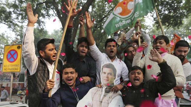 Congress party supporters hold a cut-out of party President Rahul Gandhi and celebrate outside the party headquarters in New Delhi, India, Tuesday, Dec. 11, 2018.(AP Photo)