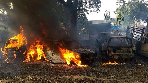 Vehicles set on fire by a mob during a protest over the alleged illegal slaughter of cattle, in Bulandshahr.(PTI file photo)