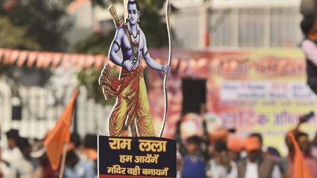 "Supporters of the Vishva Hindu Parishad (VHP) arrive to attend ""Dharma Sabha"" at Ramlila Ground in New Delhi on December 9.(Burhaan Kinu/HT PHOTO)"