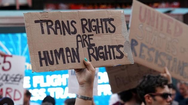 People protest U.S. President Donald Trump's announcement that he plans to reinstate a ban on transgender individuals from serving in any capacity in the U.S. military, in Times Square, in New York.(REUTERS)