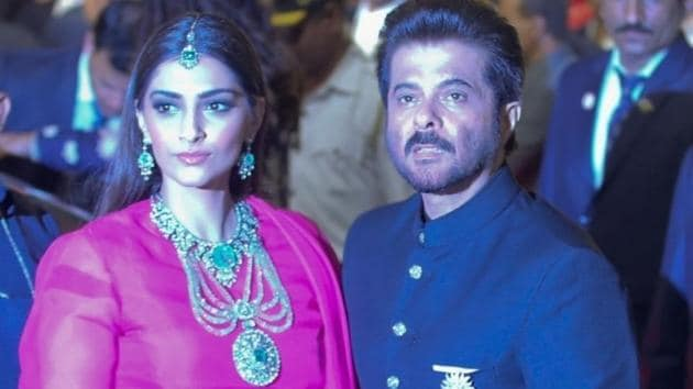 Actor Anil Kapoor with his daughter Sonam Kapoor at the wedding ceremony of industrialist Mukesh Ambani's daughter Isha Ambani and Anand Piramal at Antilia in Mumbai.(IANS)