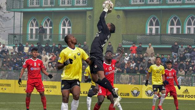 Players of Real Kashmir FC (in yellow) and Aizawl FC in action during their I-League football match in Srinagar.(PTI)