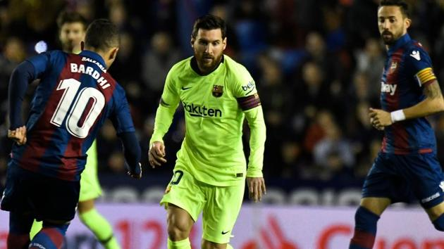 Levante's Macedonian midfielder Enis Bardhi (L) vies with Barcelona's Argentinian forward Lionel Messi during the Spanish League football match between Levante and Barcelona at the Ciutat de Valencia stadium in Valencia.(AFP)