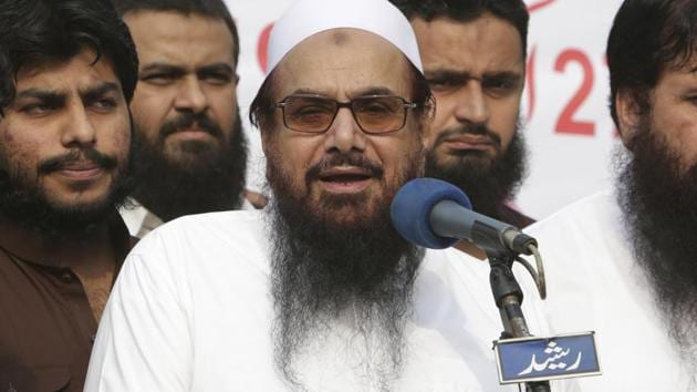 In October, Pakistan's religious affairs minister Noor-ul-Haq Qadri shared stage with Hafiz Saeed at an event in Islamabad.(AP/File Photo)
