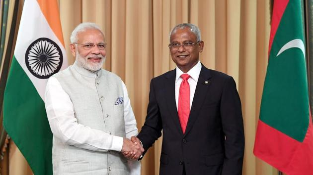 This handout photograph shows new Maldives President Ibrahim Mohamed Solih (R) shaking hands with Indian Prime Minister Narendra Modi during Solih's presidential inauguration in Male, Maldives.(AFP)