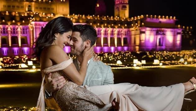 Priyanka Chopra and Nick Jonas pose at their wedding venue.