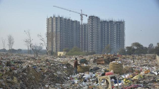 The dumping ground near Shakti Khand has been an eyesore for locals who have demanded shifting of the site.(HT Photo)