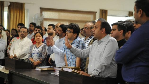 File photo of hundreds of home buyers of Greenopolis project in Gurugram's Sector 89 at the RERA office in May, 2018.(Parveen Kumar / HT File)