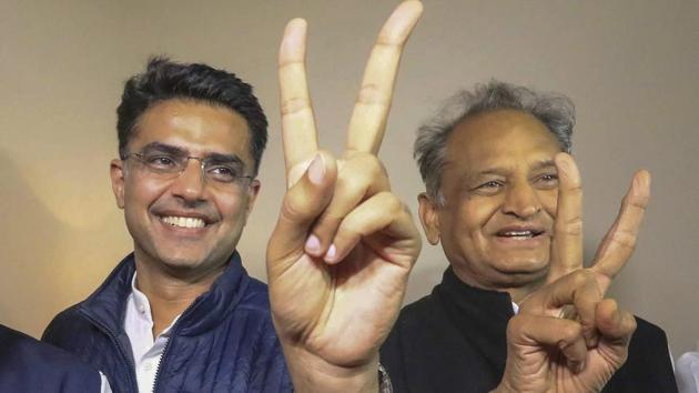 Rajasthan chief minsiter Ashok Gehlot (R) and his deputy Sachin Pilot (C in Jaipur.(PTI)