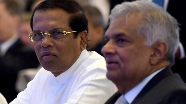 """Sri Lankan President Maithripala Sirisena (L) and Sri Lankan Prime Minister Ranil Wickremasinghe sit together during the opening of the seminar """"The Indian Ocean: Defining our Future"""" in Colombo on October 11, 2018. (Photo by ISHARA S. KODIKARA / AFP)(AFP)"""