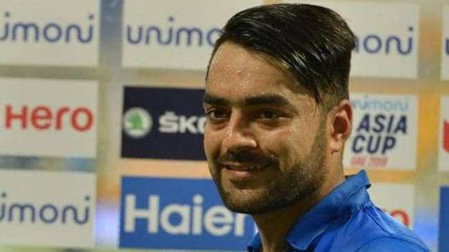 Afghan cricketer Rashid Khan poses with his award of 'Player Of The Match' after victory in the one day international (ODI) Asia Cup cricket match between Bangladesh and Afghanistan at The Sheikh Zayed Stadium in Abu Dhabi on September 20, 2018. - Afghanistan won by 136 runs. (Photo by ISHARA S. KODIKARA / AFP)(AFP)