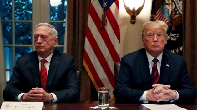 U.S. President Donald Trump speaks to the news media while gathering for a briefing from his senior military leaders, including Defense Secretary James Mattis (L), in the Cabinet Room at the White House.(REUTERS)