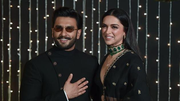 Ranveer Singh and Deepika Padukone pose as they arrive to attend wedding reception of Priyanka Chopra and Nick Jonas in Mumbai on December 20, 2018.(AFP)
