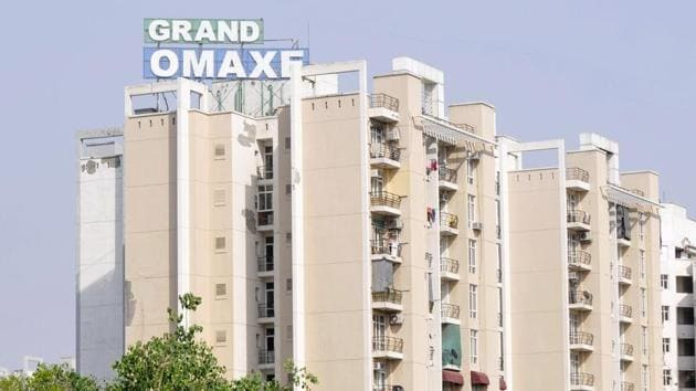 Around 300 buyers have paid the stamp duty for their properties in Sector 93B's Grand Omaxe project, but the builder is yet to clear its dues with the Noida authority.(HT Photo)