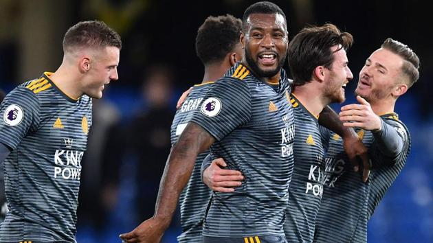 Leicester City's English-born Jamaican defender Wes Morgan (C) and teammates celebrate on the pitch after the English Premier League football match between Chelsea and Leicester City at Stamford Bridge.(AFP)
