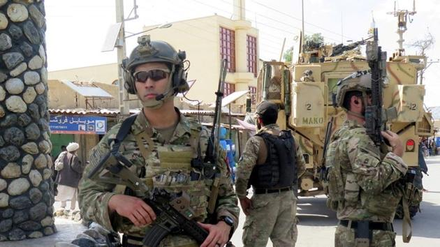 US troops keep watch in Afghanistan. US President Donald Trump has announced plans to halve the number of US troops in the war-torn country (REUTERS File Photo)(REUTERS)