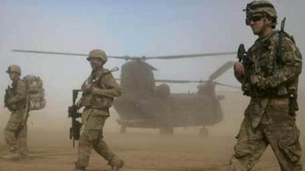 """India has been prepared for a long time now for an """"eventual"""" pullout of American troops from Afghanistan but surprised by the Trump administration's sudden decision, as the rest of the world, it wants to know more about the nature and the time-frame of the cut-back to assess implications for its involvement.(AP)"""