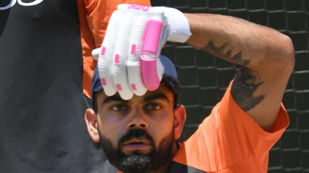India's captain Virat Kohli plays an imaginary shot during a training session in Melbourne on Monday.(AFP)
