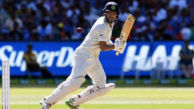 India's batsman Cheteshwar Pujara plays a shot during day one of the third cricket Test match between Australia and India in Melbourne on December 26, 2018.(AFP)