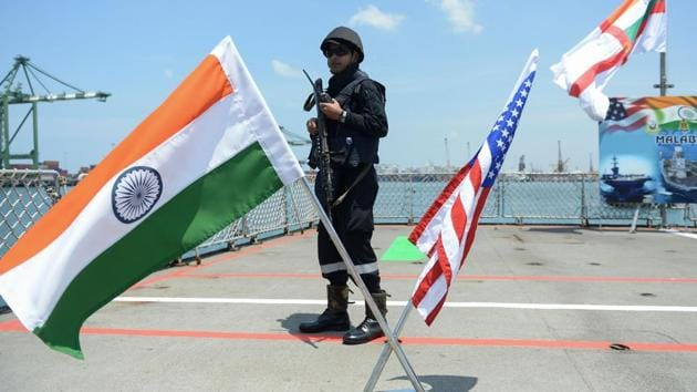 An Indian Navy sailor stands guard on the deck of the INS Shivalik during the inauguration of joint naval exercises with the United States and Japan in Chennai on July 10, 2017.(AFP file photo)