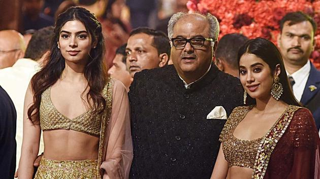 Boney Kapoor (C) with his daughters Khushi (L) and Janhvi Kapoor (R), attend the wedding of Isha Ambani with Anand Piramal in Mumbai. (Photo by - / AFP)(AFP)