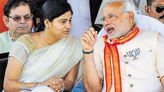 File photo of PM Narendra Modi with Apna Dal Chief Anupriya Patel at an election campaign rally in Varanasi.(PTI)