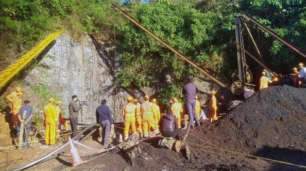 """Rescue workers were trying to reach 15 coal miners trapped underground for 13 days on Wednesday as families prayed for their safe return, but chances of survival looked slim after floodwaters rushed through the illegal """"rat-hole"""" pit in Meghalaya.(Reuters)"""