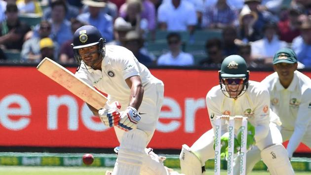 India's Mayank Agarwal (L) plays a shot as Australia's Tim Paine (C) and Usman Khawaja look on during day one of the third test match between Australia and India at the MCG.(REUTERS)