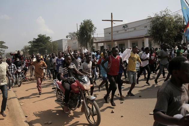 Several hundreds of people demonstrate, on December 27, 2018 in Beni, easter, Democratic Republic of Congo, to protest against the postponement of the general elections in this area because of the Ebola outbreak and the mass killings of civilians in this trouble part of DRC.(AFP)
