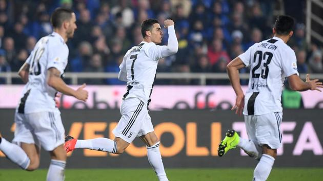 Juventus' Cristiano Ronaldo celebrates scoring their second goal(REUTERS)