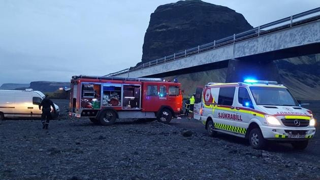 In this UGC photo provided by Tour guide Adolf Erlingsson on Thursday, Dec. 27, 2018 , emergency services at the scene of a crash, in Skeidararsandur, Iceland. An SUV carrying seven members of a British family plunged off a high bridge Thursday in Iceland, killing three people and critically injuring the others, authorities said. (Adolf Erlingsson via AP)(AP)