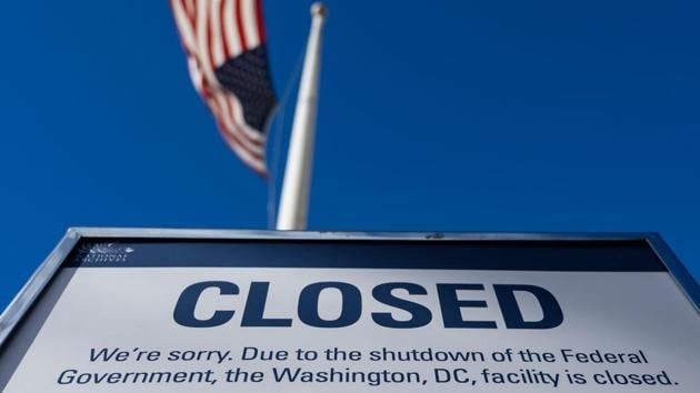 A sign is displayed on a government building that is closed because of a US government shutdown in Washington, DC (AFP File Photo)(AFP)