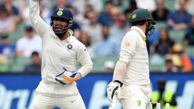 India's wicketkeeper Rishabh Pant (L) makes an unsuccessful leg before wicket appeal against Australia's batsman Travis Head (R).(AFP)