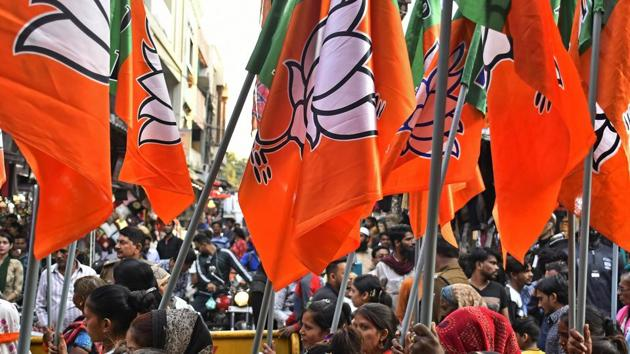 Supporters of the Bharatiya Janata Party (BJP) carry flags during a rally in Bhopal, Madhya Pradesh on November 21.(Bloomberg)