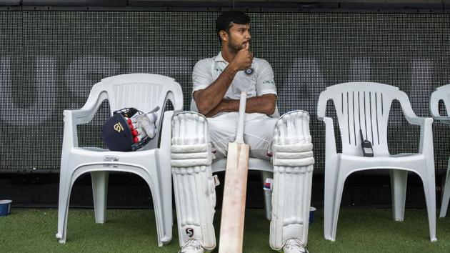 India's Mayank Agarwal sits on the bench before the start of play on day four of the third cricket test between India and Australia in Melbourne.(AP)