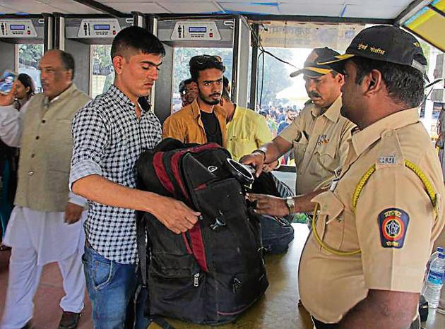 Mumbai Police check the bags of tourists at the Gateway of India on Sunday.(Bhushan Koyande/HT)