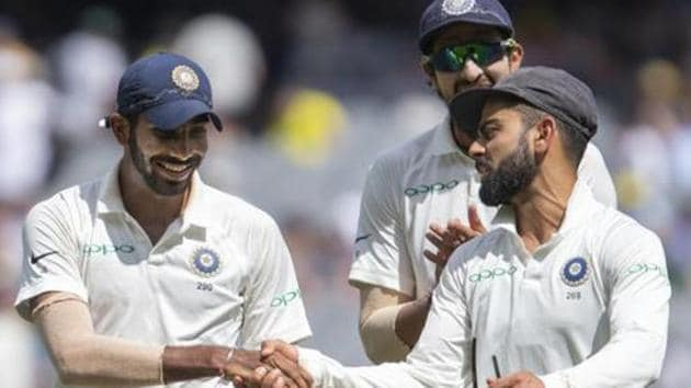 India's captain Virat Kohli, right, shakes hands with Jasprit Bumrah after Bumrah got 6 wickets during play on day three of the third Test against Australia.(AP)