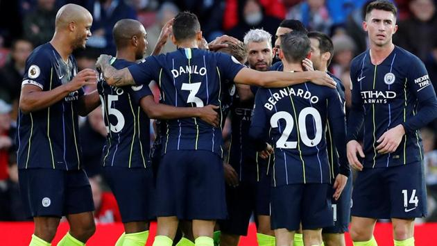 Manchester City's Sergio Aguero celebrates with team mates after scoring their third goal.(REUTERS)