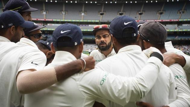 India's captain Virat Kohli, center, addresses his teammates as they prepare to take to the field during play on day four of the third cricket test between India and Australia in Melbourne, Australia, Saturday, Dec. 29, 2018)(AP)