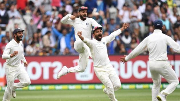 India's captain Virat Kohli, Cheteshwar Pujara and Ajinkya Rahane celebrate after winning the third Test against Australia.(REUTERS)