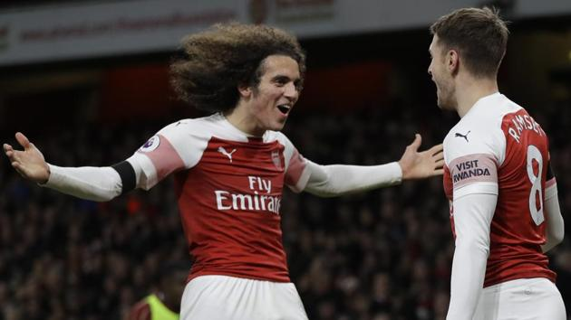 Arsenal's Aaron Ramsey ( right) celebrates with Matteo Guendouzi after scoring his side's third goal.(AP)