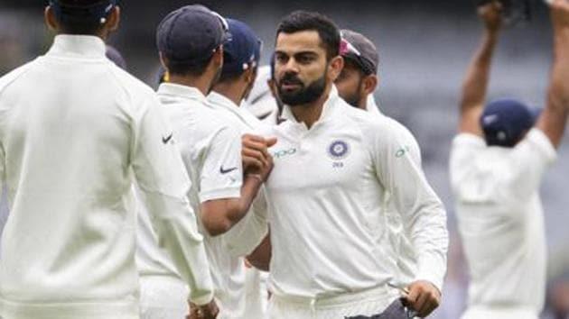 India's captain Virat Kohli, center, congratulates his teammates after India defeated Australia in Melbourne.(AP)