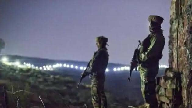 In this file photo, Indian Army soldiers can be seen at a post before the illuminated fence in Hamirpur area near Bhimber Gali, about 180km northwest of Jammu.(HT File Photo)
