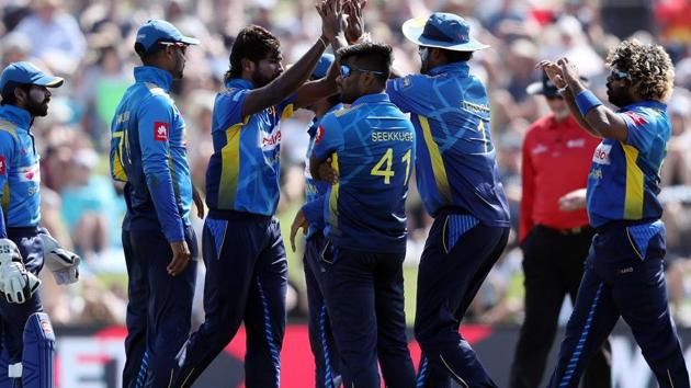 Sri Lanka players celebrate the wicket of Kane Williamson during the first one-day international cricket match against New Zealand.(AFP)
